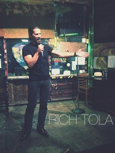 Rich Tola performing at the Tribal Cafe